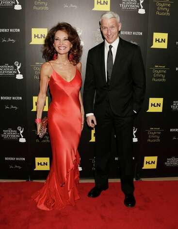 Susan Lucci, left, and Anderson Cooper arrive at the 39th Annual Daytime Emmy Awards at the Beverly Hilton Hotel on Saturday, June 23, 2012, in Beverly Hills, Calif. Photo: TODD WILLIAMSON/INVISION/AP
