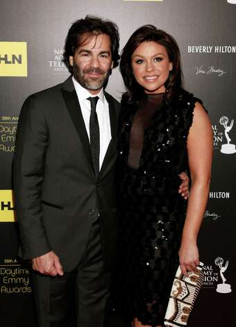 John Cusimano, left, and Rachael Ray arrive at the 39th Annual Daytime Emmy Awards at the Beverly Hilton Hotel on Saturday, June 23, 2012 in Beverly Hills, Calif. Photo: TODD WILLIAMSON/INVISION/AP