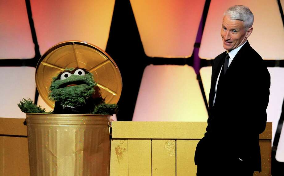The character Oscar the Grouch, left, and Anderson Cooper appear onstage at the 39th annual Daytime Emmy Awards at the Beverly Hilton Hotel in Beverly Hills, Calif., on Saturday, June 23, 2012. Photo: CHRIS PIZZELLO/INVISION/AP