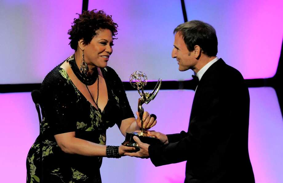 "Kim Coles, left, presents the talk show - entertainment award to Michael Gelman for ""Live with Regis and Kelly"" onstage. Photo: CHRIS PIZZELLO/INVISION/AP"