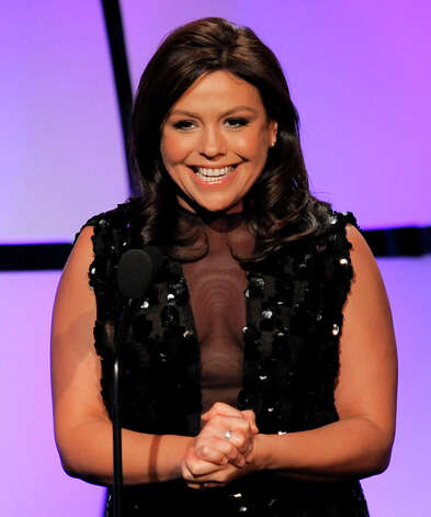 Rachael Ray presents an award onstage at the 39th Annual Daytime Emmy Awards at the Beverly Hilton Hotel on Saturday, June 23, 2012 in Beverly Hills, Calif. Photo: CHRIS PIZZELLO/INVISION/AP