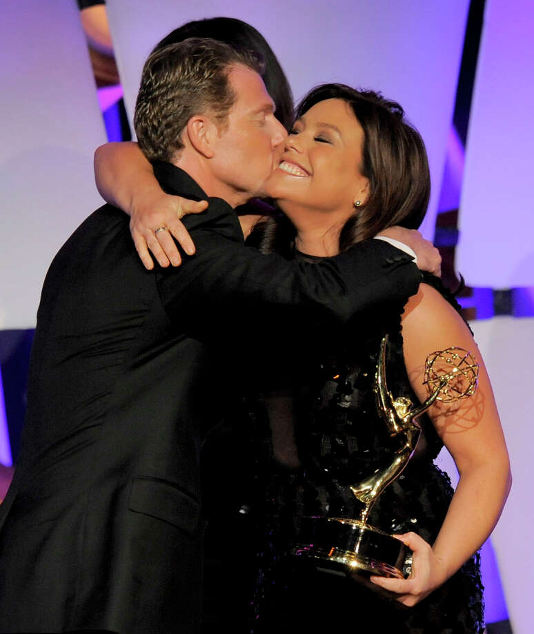 "Rachael Ray, right, presents the culinary program award to Bobby Flay for ""Barbecue Addiction"" onstage. Photo: CHRIS PIZZELLO/INVISION/AP"