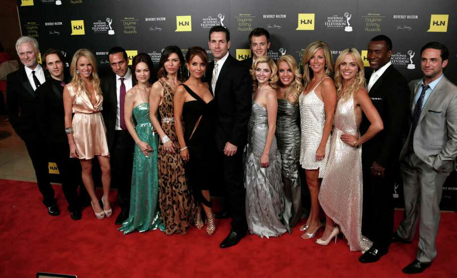 "The cast and crew of ""General Hospital,"" winners of the award for drama series, pose backstage. Photo: TODD WILLIAMSON/INVISION/AP"