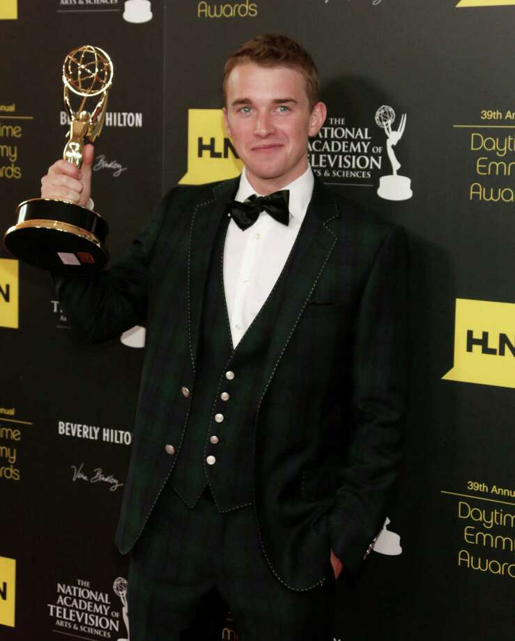 "Chandler Massey poses backstage with the award for outstanding younger actor in a drama series for ""Days of our Lives"". Photo: TODD WILLIAMSON/INVISION/AP"