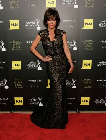 Lisa Rinna poses backstage at the 39th Annual Daytime Emmy Awards at the Beverly Hilton Hotel on Saturday, June 23, 2012 in Beverly Hills, Calif. Photo: TODD WILLIAMSON/INVISION/AP