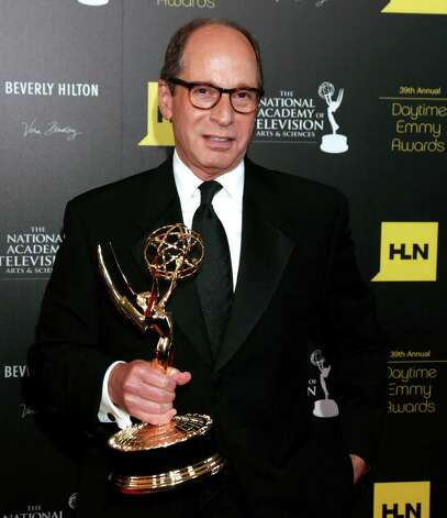 "Harry Friedman poses backstage with the award for game/audience participation show for ""Jeopardy!"" at the 39th Annual Daytime Emmy Awards at the Beverly Hilton Hotel on Saturday, June 23, 2012 in Beverly Hills, Calif. Photo: TODD WILLIAMSON/INVISION/AP"