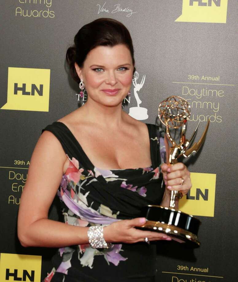 "Heather Tom poses backstage with the award for lead actress in a drama series for ""The Bold and the Beautiful."" Photo: TODD WILLIAMSON/INVISION/AP"