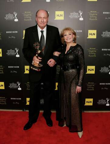 Bill Geddie, left, and Barbara Walters pose backstage with Geddie's lifetime achievement award at the 39th Annual Daytime Emmy Awards at the Beverly Hilton Hotel on Saturday, June 23, 2012 in Beverly Hills, Calif. Photo: TODD WILLIAMSON/INVISION/AP