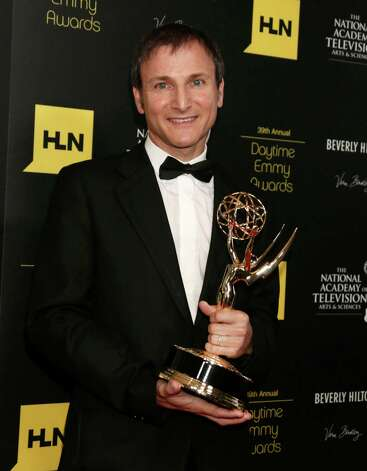 "Michael Gelman poses backstage with the talk show - entertainment award for ""Live with Regis and Kelly"" at the 39th Annual Daytime Emmy Awards at the Beverly Hilton Hotel on Saturday, June 23, 2012 in Beverly Hills, Calif. Photo: TODD WILLIAMSON/INVISION/AP"