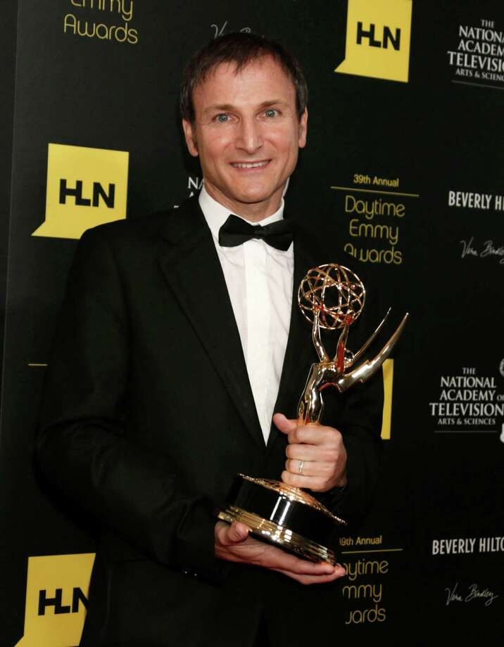 "Michael Gelman poses backstage with the talk show - entertainment award for ""Live with Regis and Kelly."" Photo: TODD WILLIAMSON/INVISION/AP"