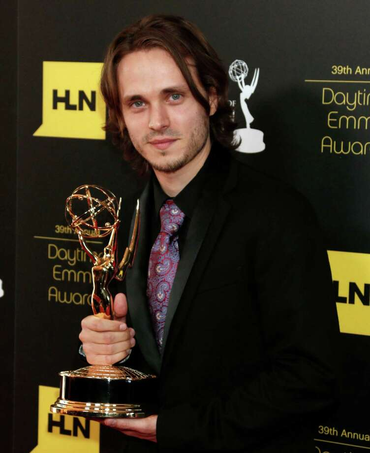 "Jonathan Jackson poses backstage with the award for supporting actor in a drama series for ""General Hospital."" Photo: TODD WILLIAMSON/INVISION/AP"