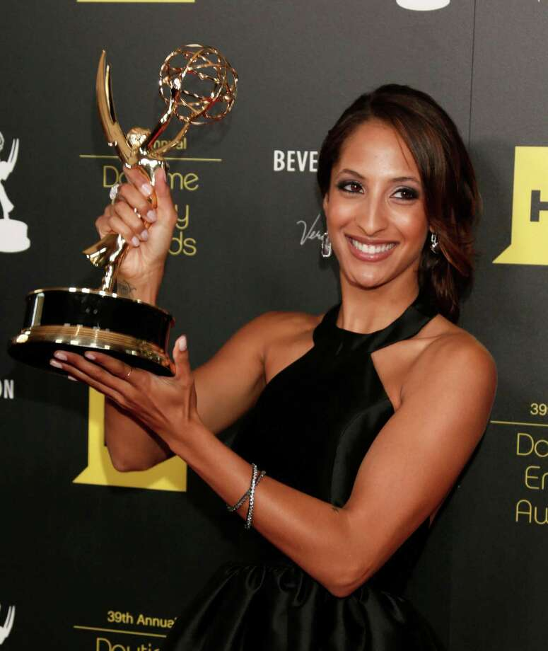 "Christel Khalil poses backstage with the award for outstanding younger actress in a drama series for ""The Young and the Restless."" Photo: TODD WILLIAMSON/INVISION/AP"