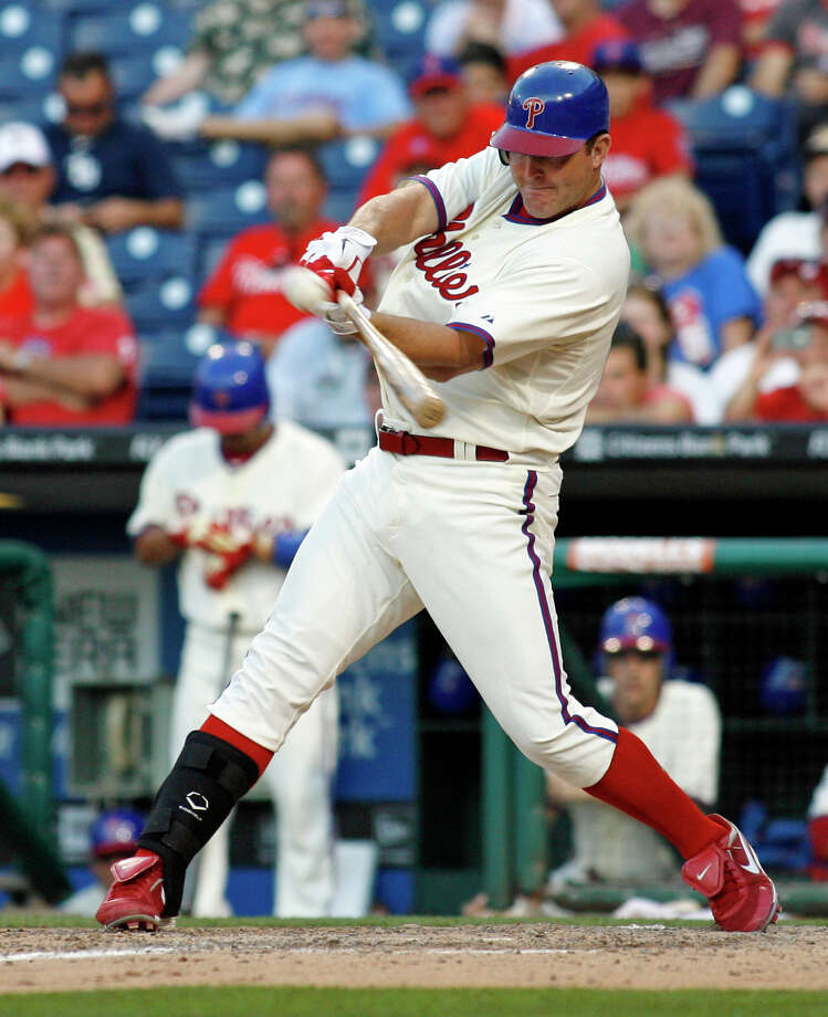 Philadelphia Phillies' Jim Thome hits the game-winning home run against the Tampa Bay Rays in the ninth inning of an interleague baseball game Saturday, June 23, 2012, in Philadelphia. Phillies won 7-6. (AP Photo/H. Rumph Jr) Photo: H. RUMPH JR / FR61717 AP