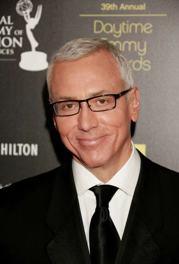 Dr. Drew Pinsky arrives. Photo: Todd Williamson / 2012 AP