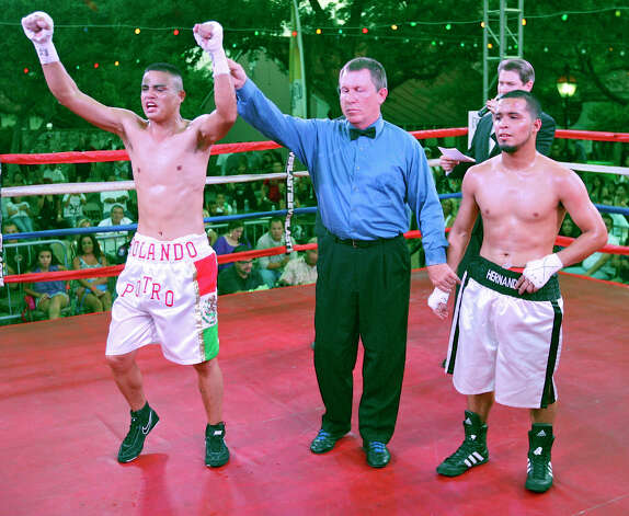 Rolando Campos (left) celebrates his unanimous decision win over Henry Hernandez (right) after their boxing match Saturday June 23, 2012 at Maverick Plaza in La Villita. Photo: Edward A. Ornelas, Express-News / © 2012 San Antonio Express-News