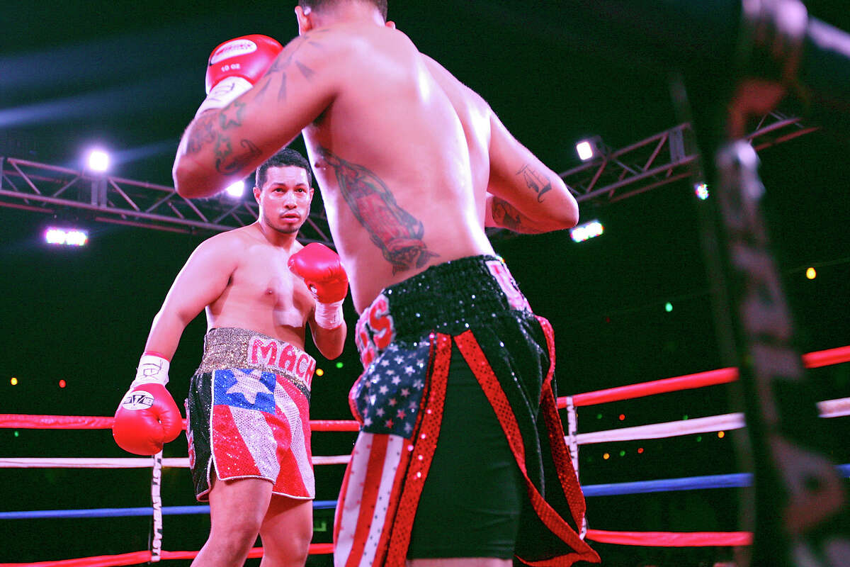 Hector Camacho Jr. (left) and Jon David Charles move around the ring during the first round of their boxing match Saturday June 23, 2012 at Maverick Plaza in La Villita. Camacho won with a first round knockout.