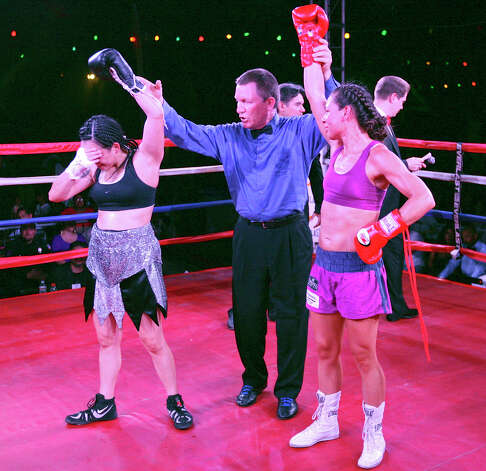 Christina Ruiz (left) and Nohime Dennisson react after their boxing match Saturday June 23, 2012 at Maverick Plaza in La Villita. The fight was a majority draw. Photo: Edward A. Ornelas, Express-News / © 2012 San Antonio Express-News