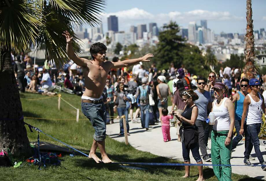 Will Novey walks on a string at Dyke March at Dolores Park on Saturday, June 23rd, 2012 in San Francisco, Calif. Photo: Jill Schneider, The Chronicle