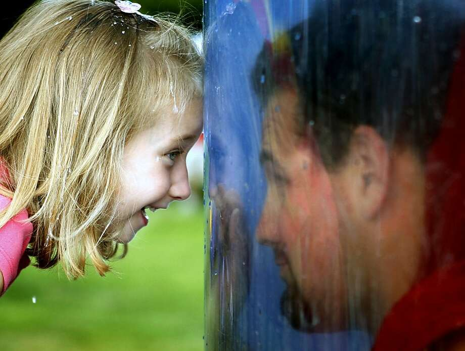 Dunkin' Dad:Four-year-old Raelynn Vannier smiles at her 