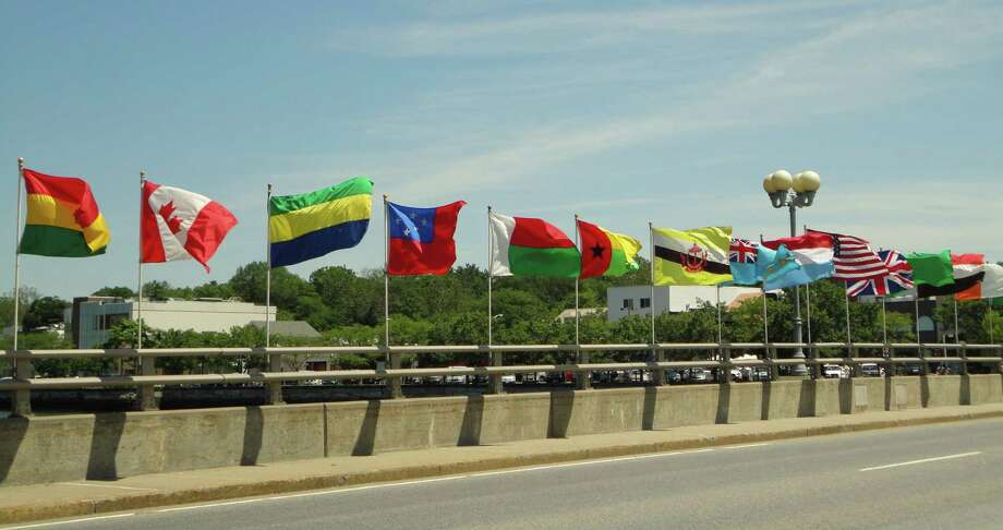 Flags from dozens of nations whipped in the breeze on the north side of the Ruth Steinkraus-Cohen Bridge in downtown Westport Saturday. The annual tradition of displaying the flags from around the globe coincides with the annual jUNe Day celebration, marking its 47th year. Photo: Meg Barone / Westport News freelance