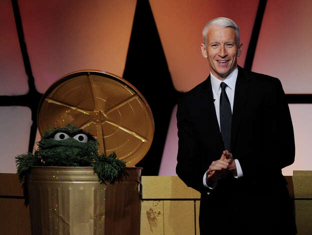 BEVERLY HILLS, CA - JUNE 23:  CNN Anchor Anderson Cooper (R) and Oscar the Grouch appear onstage at the 39th Annual Daytime Entertainment Emmy Awards at the Beverly Hilton Hotel on June 23, 2012 in Beverly Hills, California.  (Photo by Kevin Winter/Getty Images) Photo: Kevin Winter, Getty Images / Getty Images
