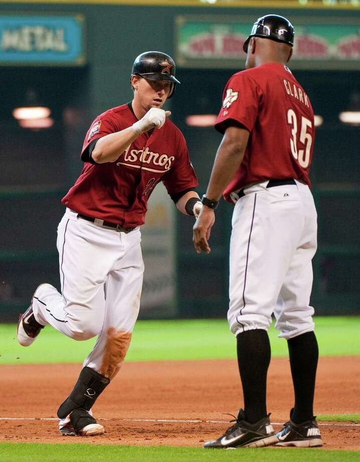 Houston Astros' Chris Johnson, left, is congratulated by third base coach Dave Clark (35) after hitting a two-run home run during the eighth inning of an interleague baseball game against the Cleveland Indians, Sunday, June 24, 2012, in Houston. The Astros defeated the Indians 7-1. Photo: AP