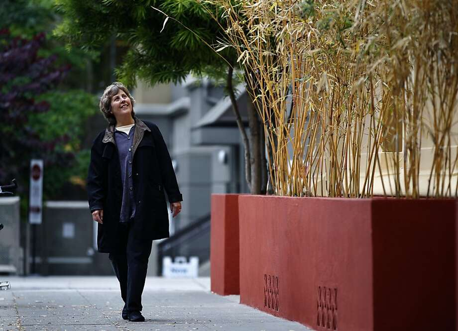 Robin Caton, director of the Dharma College, walks on Harold Way in front of her school in Berkeley, Calif. on Thursday, June 21, 2012. Caton came up with the idea to rename the street to Dharma Way to reflect the concentration of Buddhist organizations located there. Photo: Paul Chinn, The Chronicle