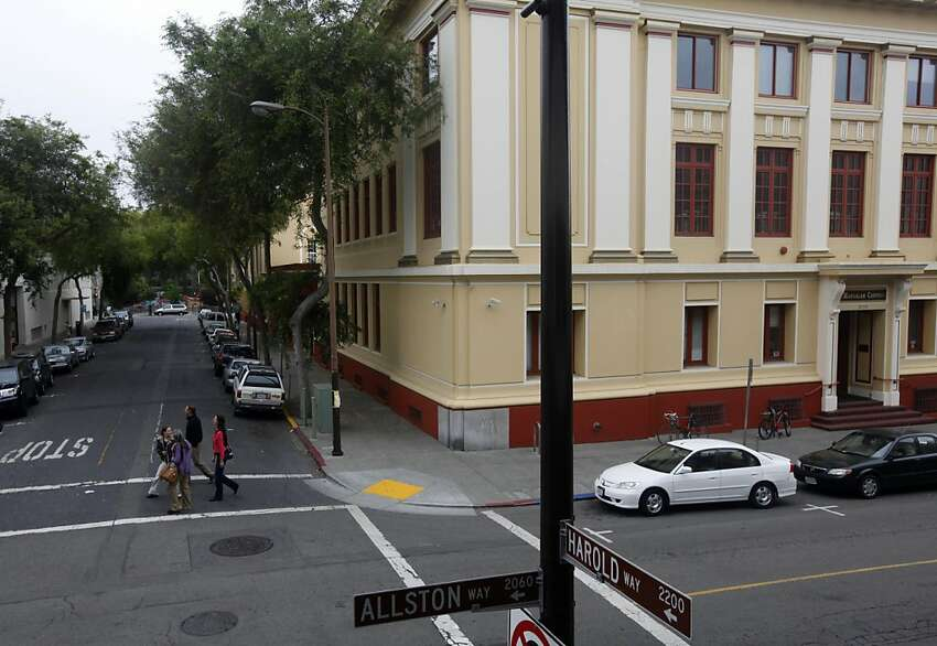 Pedestrians walk across Harold Way in downtown Berkeley, Calif. on Thursday, June 21, 2012. The city council is set to approve the renaming of the one block street to Dharma Way to reflect the concentration of Buddhist organizations located there.