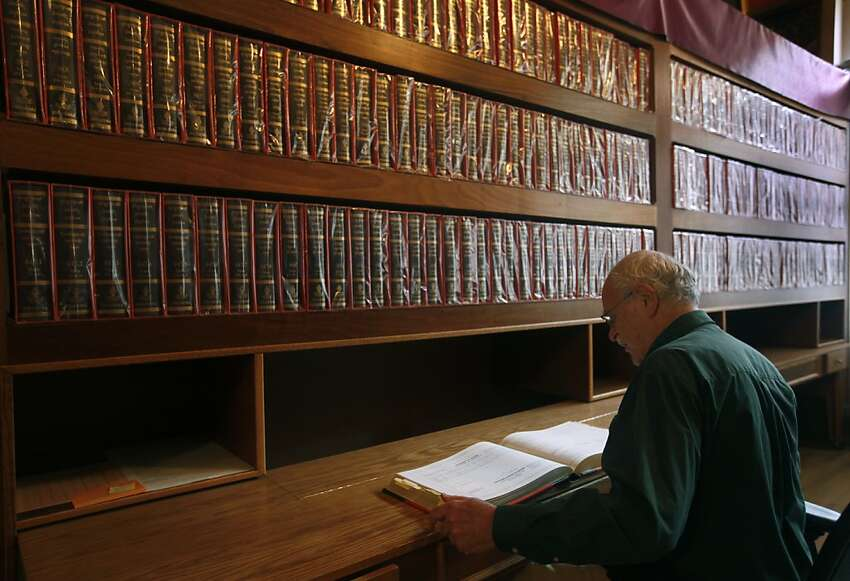 Jack Petranker, the director of the Mangalam Research Center, views a Tibetan text in the center's library in Berkeley, Calif. on Thursday, June 21, 2012. The city council is set to approve the renaming of Harold Way to Dharma Way to reflect the concentration of Buddhist organizations located on the one block street.