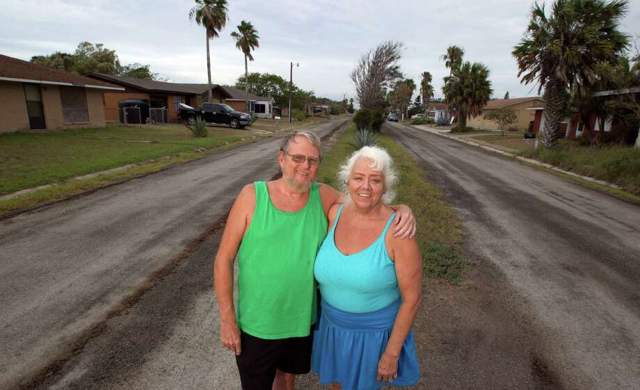 Terry Heaton left, and his wife Bonnie Heaton residents of Kopernik Shores neighborhood near Boca Chica Beach stands in front of the Weems street which is the the main street in the neighborhood near the proposed site for SpaceX spaceport Tuesday, June 19, 2012, in Brownsville. The Heaton's are opposed to the proposed spaceport. Photo: James Nielsen, Chronicle / © Houston Chronicle 2012