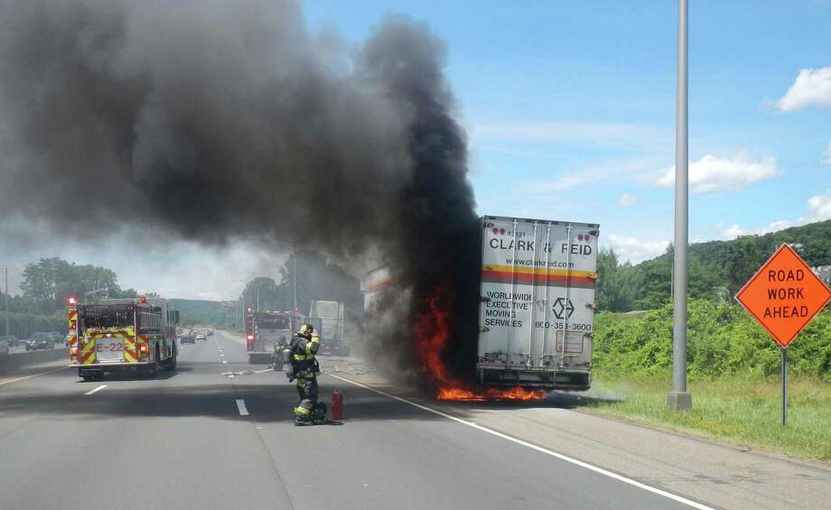Danbury firefighters extinguished a blaze on a tractor-trailer on Interstate 84 on Sunday, saving the belongings of a Massachusetts family moving to Texas. Photo: Courtesy Danbury Fire Department