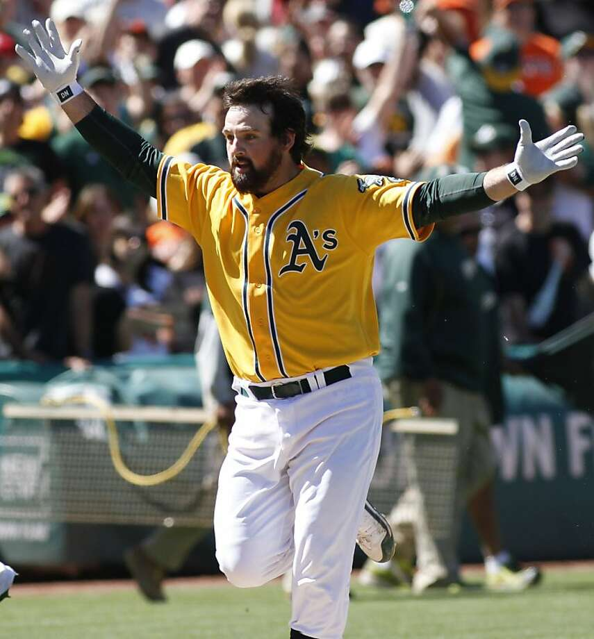 Oakland Athletics' Derek Norris rounds third base after hitting a game-winning three-run home run against the San Francisco Giants during the ninth inning of an interleague baseball game on Sunday, June 24, 2012, in Oakland, Calif. (AP Photo/George Nikitin) Photo: George Nikitin, Associated Press