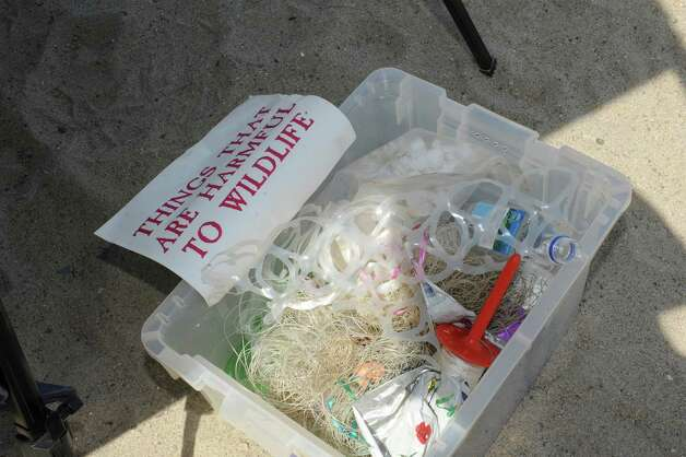 A container of things that are harmful to wildlife during Experience the Sound Sunday, June 24, 2012. The sixth annual event was held by the Greenwich Shellfish Commission to coincide with the opening of the Bruce Museum's Seaside Center. Photo: Helen Neafsey / Greenwich Time