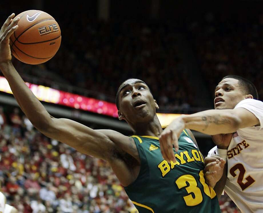 Baylor forward Quincy Miller, left, catches a pass over Iowa State guard Chris Babb, right, during the first half of an NCAA college basketball game, Saturday, March 3, 2012, in Ames, Iowa. (AP Photo/Charlie Neibergall) Photo: Charlie Neibergall, Associated Press