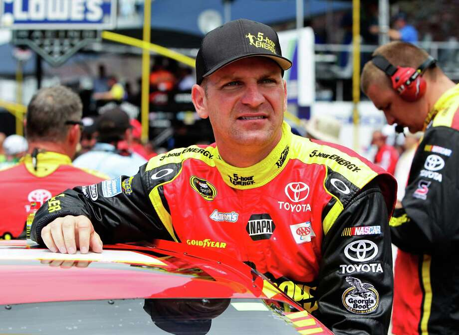 BROOKLYN, MI - JUNE 17:  Clint Bowyer, driver of the #15 5-hour Energy Toyota, stands on the grid during pre-race ceremonies for the NASCAR Sprint Cup Series Quicken Loans 400 at Michigan International Speedway on June 17, 2012 in Brooklyn, Michigan.  (Photo by Wesley Hitt/Getty Images for NASCAR) Photo: Wesley Hitt / 2012 Getty Images