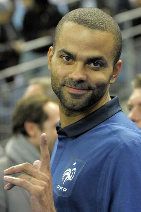 (FILES)French basketball player Tony Parker waves in this October 11, 2011 file photo before giving the kickoff of the UEFA Euro 2012 Group D qualifying football match France vs. Bosnia-Herzegovina at the Stade de France in Saint-Denis, a northern suburb of Paris.   NBA star Tony Parker is suing the owners of a New York nightclub after suffering an eye injury in a bottle-throwing brawl between friends of R&B singer Chris Brown and rapper Drake, the New York Post reported on June 22, 2012. Parker, who plays for the San Antonio Spurs, is demanding $20 million from the owners of the W.i.P. (Work in Progress) club in the SoHo neighborhood of Manhattan following the fight in the early hours of June 14, the newspaper said. AFP PHOTO / BERTRAND GUAYBERTRAND GUAY/AFP/GettyImages Photo: BERTRAND GUAY / AFP ImageForum
