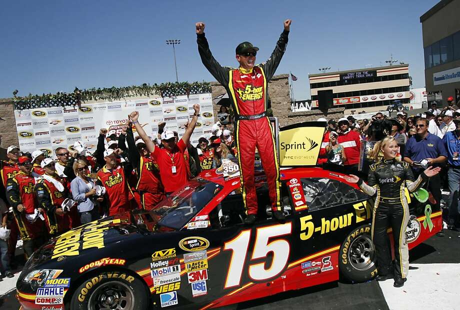 Clint Bowyer celebrates on top of his 5-hour Energy Toyota after winning the Toyota/Save Mart 350 NASCAR Sprint Cup Series race at Infineon Raceway in Sonoma, Calif., Sunday, June 24, 2012. Photo: Sarah Rice, Special To The Chronicle