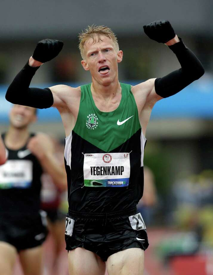 Matt Tegenkamp reacts after finishing the men's 10,000m finals at the U.S. Olympic Track and Field Trials Friday, June 22, 2012, in Eugene, Ore. Galen Rupp finished first, Tegenkamp second and Ritzenhein third. The three will represent the U.S. in the London Olympics. (AP Photo/Eric Gay) Photo: Associated Press