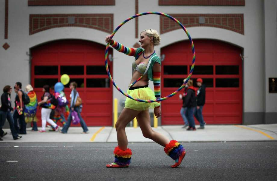 Evelyn Kennedy marches with a hula hoop. Photo: JOSHUA TRUJILLO / SEATTLEPI.COM
