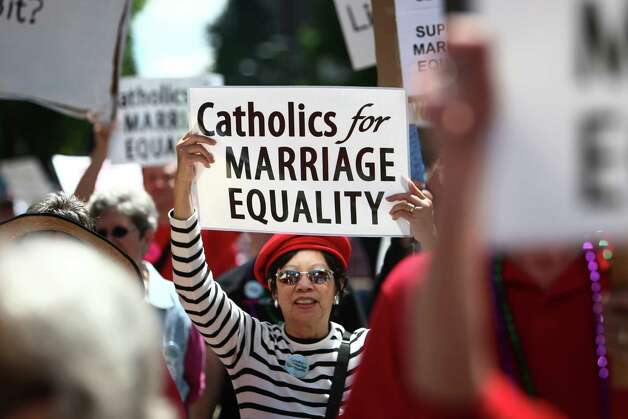 "Catholics march for marriage equality during Seattle's annual Pride Parade last June.  The parade featured tens of thousands of people celebrating a year that included the repeal of the ""don't ask, don't tell"" policy in the U.S. military and passage of gay marriage rights in Washington State. Photo: JOSHUA TRUJILLO / SEATTLEPI.COM"