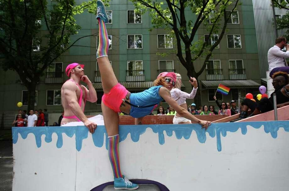 A parade participant strikes a pose on a float. Photo: JOSHUA TRUJILLO / SEATTLEPI.COM