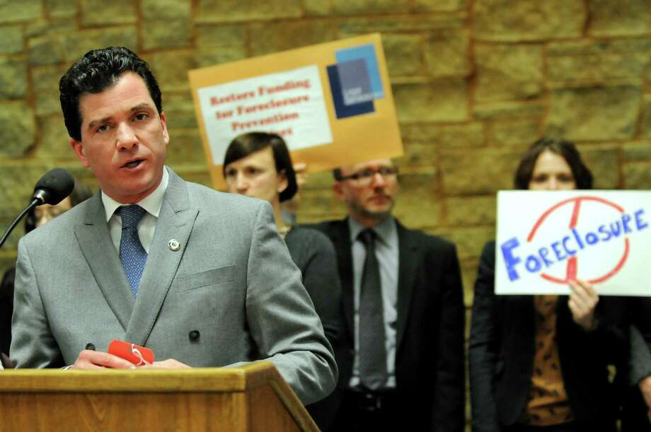 Sen. Mark Grisanti of Buffalo, left, speaks during a news conference to help homeowners prevent foreclosure on Tuesday, Jan. 31, 2012, at the Legislative Office Building in Albany, N.Y. (Cindy Schultz / Times Union) Photo: Cindy Schultz