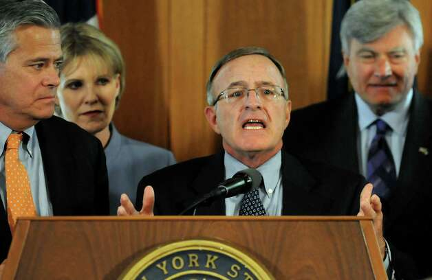 Sen. John DeFrancisco, center, speaks during a news conference in response to the Democrats meeting on Wednesday, April 14, 2010, at the Capitol in Albany, N.Y. (Cindy Schultz / Times Union) Photo: CINDY SCHULTZ