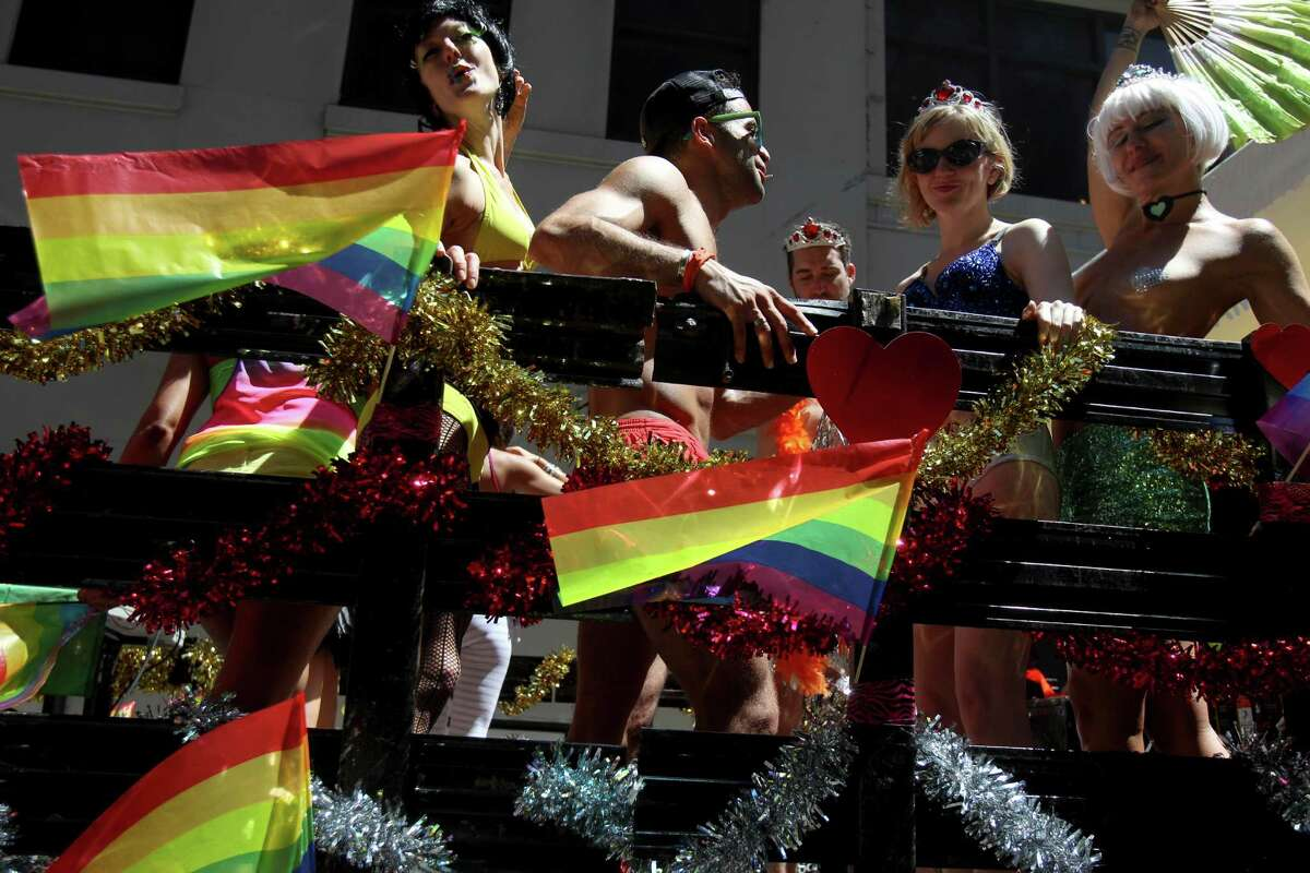 Participants in the Gay Pride Parade pose for picture before the start of the parade in New York, Sunday, June 24, 2012. The parade was held one year to the day of same-sex marriage being legalized in New York state.