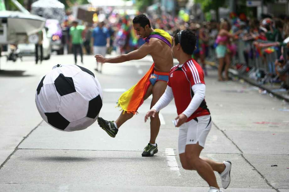 Parade participants kick a large soccer ball. Photo: JOSHUA TRUJILLO / SEATTLEPI.COM
