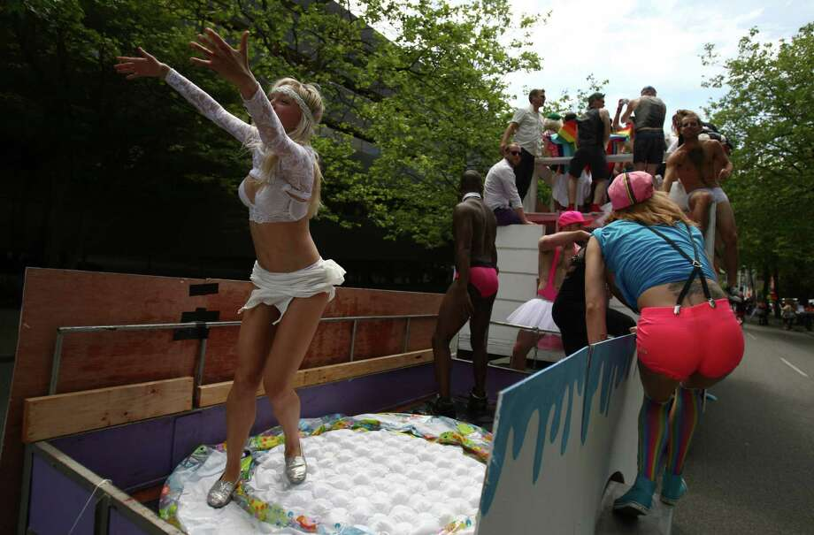 Participants ride on a float. Photo: JOSHUA TRUJILLO / SEATTLEPI.COM