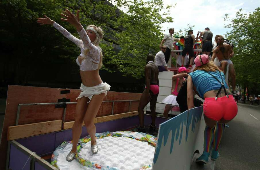 Participants ride on a float.
