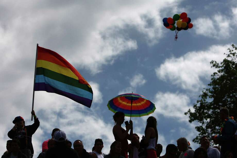 Rainbow-colored balloons float away as people gather at Seattle Center after the parade. Photo: JOSHUA TRUJILLO / SEATTLEPI.COM
