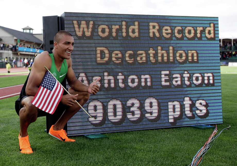 Ashton Eaton poses for a picture after the 1500m during the decathlon competition at the U.S. Olympic Track and Field Trials Saturday, June 23, 2012, in Eugene, Ore. Eaton finished the decathlon with a new world record. (AP Photo/Matt Slocum) Photo: Associated Press