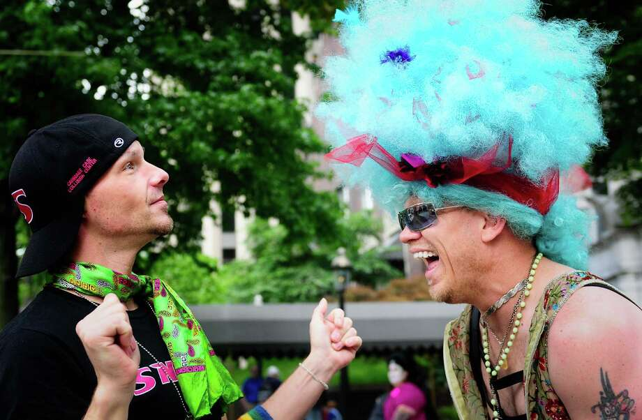 Horus Kai, right, laughs as Tye Garsen, left, puts the finishing touches on his wig as they prepare. Photo: LINDSEY WASSON / SEATTLEPI.COM